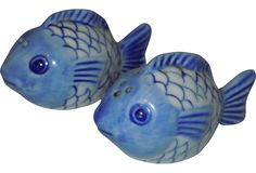 A pair of charming vintage blue and white fish-shaped salt and pepper shakers.