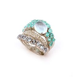 Ring in 18k white gold with round diamonds, aquamarine and parahyba tourmaline.