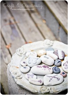 Decorated rocks (These would go perfectly in my blue bird container in the bathroom!! I even have the bird/butterfly rub ons!)