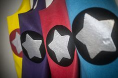 I decided that I would create some easy felt superhero capes for B's fifth b'day but knowing my current level of dedication to crafty ventures I did not want to take on more than I could handle so these little capes are very simple, no-sew and inexpensive! Woo-hoo! Ok on with the deets ....