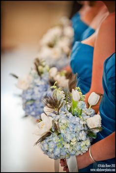 Wedding bouquets of blue hydrangeas, white tulips & peacock feathers.  Photos by www.Colinhowephoto.com, flowers by Floral Creations by Sharon