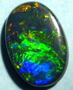Magnificent Australian Lightning Ridge Black Opal, 13x9mm