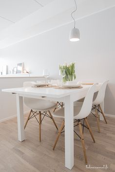 Minimalist white Scandinavian kitchen ready for spring. Clean lines and natural color palette keep it looking bright and inviting.