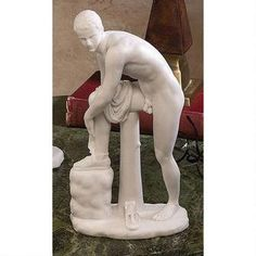 This Roman statue of a resting athlete, pays homage to a lost Greek bronze original. Replicated by many famed sculptors through the ages and said to represent various gods from Jason to Mercury to Her