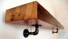 rustic style -- salvaged wood slab shelf mounted on steel piping
