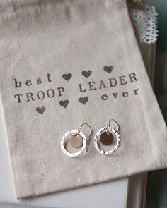 """Girl Scout Troop Leader appreciation gift idea. Mixed metal earrings in gift pouch. """"Make new friends, but keep the old. One is silver, the other is gold. A circle is round, it has no end. That's how long I want to be your friend."""""""
