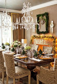 Zebra-print upholstered chairs add a little sass to this sparkling dining room. ~ 50 Stunning Christmas Tablescapes - Christmas Decorating - Style Estate