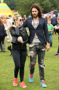 Cosying up: Russell Brand, 40, was pictured with a mystery blonde while attending the Baltonsborough Village Show in Somerset on Sunday