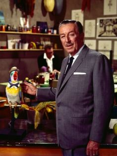 Walt working on the Enchanted Tiki Room inventing the future of robotics, audio-animatronics.