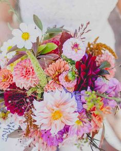 Colorful Dahlia Wedding Bouquet | Martha Stewart Weddings - Don't limit yourself on color, especially during the spring season, which brings about so many fun and beautiful shades. Make your bouquet pop by accenting with different dahlias, daisies, and even hints of lavender and green-seeded eucalyptus, like this gorgeous number from Moonflower Design Studio.