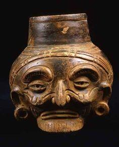 "Toltec Plumbate Head Effigy Vessel - PF.2942 Origin: Soconusco, Guatemala Circa: 1000 AD to 1200 AD  Dimensions: 5.25"" (13.3cm) high x 4.125"" (10.5cm) wide  Collection: Pre-Columbian Medium: Plumbate"