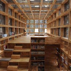 Liyuan Library, China, by Li Xiaodong    This small, single-storey library in Liyuan houses its book collection within its chunky timber framework, including a stepped platform with integrated shelves that double as seating for readers.