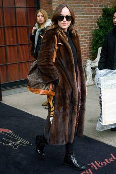 Dakota Johnson in Gucci coat and Louis Vuitton bag