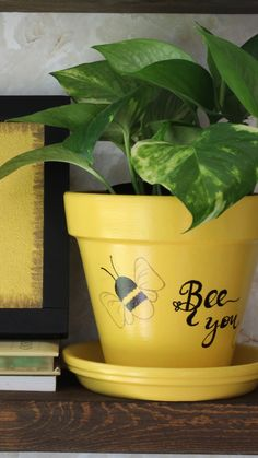 Buzz into spring with this inspiration hand painted planter. Features bees and it reminds you to Bee You, the special person you are. A cute indoor terra cotta planter that is available among my Etsy products. Flower Pot Art, Small Flower Pots, Clay Flower Pots, Flower Pot Crafts, Clay Pot Crafts, Clay Pots, Painted Plant Pots, Painted Flower Pots, Decorated Flower Pots