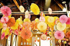 yellowpinkorangecolorfulweddingrecipetiondecorpaperpinwheels.jpg (500×333)