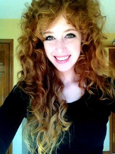 Layered curly red hair