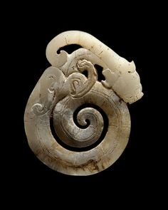 Ornament of a Coiled Feline Dragon Han Dynasty, 220 BCE - 220 CEJadeH: 2 5/8 in. W: 2 in. Th: 1/4 inFrom Throckmorton Fine Art