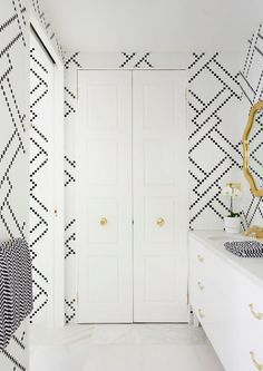 adore magazine, black and white tile bathroom, white cabinets, gold hardware, gold mirror, black and white striped towels