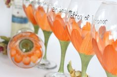 Cute gift idea for bridal party. DIY wine glasses with the color of the gerbra daisy that matches the color of the girls dress. :)