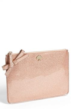A pretty rose gold makeup bag!  I couldn't justify it, but it's so cute.  kate spade