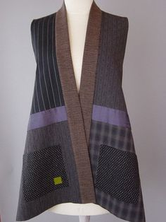 Long Kimono Vest in Browns Earthy and soft, this vest is pieced from various Japanese yarn dyed cloths and an area of white stitched voile overlay. Hand woven neckband, beautiful grayed lavender silk accent and pockets.