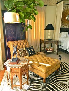 Zebra rub with butterscotch chaise in this well decorated sitting room off the master bedroom.