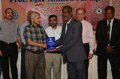 Mr. Shafiq Kazmi Secretary KCCA giving Shield to Amir Uddin Ansari
