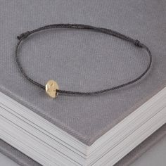 gold star silk bracelet