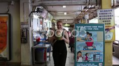Girl drinks from a Coconut in Chinatown - Stock Footage   by JahnProductions