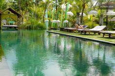 BEAUTIFUL SWIMMING POOL IN A LARGE PARK WITH TREE HOUSES, STATUES, CARVED BENCHES, PAVILIONS