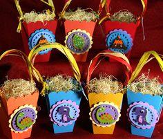 Dinosaur Treat Bags or Popcorn Box -- Set of 12 -- Dinosaur Party -- Boy Birthday -- Dinosaur Birthday -- Thank you Bags. $36.99, via Etsy.