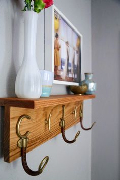 I love this entryway - it's beautiful! This DIY coat rack is so cute! It's such an easy project to put together, and it makes a huge difference in how the whole entryway looks.