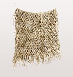 Seagrass Wall Hanging: Bring a tropical vibe to your home with this stunning hand woven seagrass wall hanging by W.A.Green London - a fun textural piece that screams boho glamour with an enviable laid back attitude. Hand made from natural seagrass with jute string for hanging.