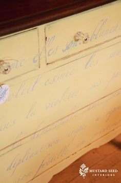 Use a stencil for the light french words on the dresser. Simply beautiful!