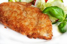 Recipe including course(s): Entrée; and ingredients: black pepper, bread crumbs, butter, chicken breast, garlic powder, parmesan cheese, ranch salad dressing, seasoning salt
