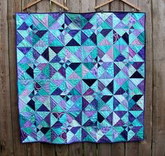 This quilt is made up of 16 of these 12 inch blocks. Description from wombatquilts.com. I searched for this on bing.com/images