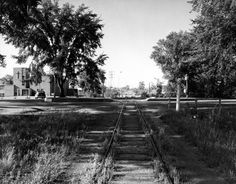 This was the scene in 1955 before the railway tracks were removed near Island Park. That's the Kitchissippi United Church in the background. Photo courtesy of the City of Ottawa archives Click image to enlarge. Ottawa Valley, University Of Ottawa, Island Park, Railroad Tracks, Ontario, Vintage Photos, Past, Country Roads, Scene