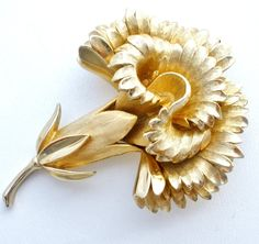 """Floral Jewelry Brooches - This is a superb gold tone vintage carnation brooch by Trifari. It measures 2.1"""" by 1.5"""", signed Trifari with a crown over the T for Crown Trifari and in excellent condition."""