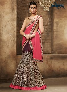 Fashion and trend would be at the peak of your beauty as soon as you dresses this pink georgette lehenga saree. Beautified with embroidered and patch border work all synchronized nicely with the desig...