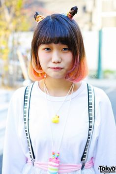 Elleanor is an 18-year-old English-speaking vintage/resale-loving student who we often see in Harajuku. Her look features an ombre bob hairstyle, a sheer skirt, suspenders, and striped boots. Check all of Elleanor's snaps here. #tokyofashion #Harajuku