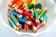 I organized my daughter's embroidery floss (friendship bracelet supplies) using wooden clothes pins.