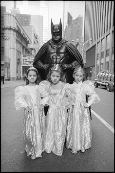 Three princesses that are feeling SUPER to be protected and escorted by Batman!  ---   (photo by Mary Ellen Mark)