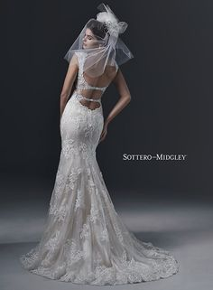 Pure romance is found in this fit and flare wedding dress with lace, pearls and Swarovski crystals... Plus a stunning double keyhole back. Brecia by Sottero and Midgley.