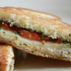 Toasted Pesto Tomato Sandwich | Basil plants giving you a bumper crop? Don't let it go to waste. Prolific basil adds robust flavor to any dish. Whip up some pesto so you can enjoy this light, buttery summer sandwich. This sandwich is out of this world delicious with that other summer wonder -- heirloom tomato slices. | GNOWFGLINS.com