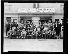 Group portrait of NAACP members at the Kansas conference of the NAACP, posed outside of a motion picture theater, 1944