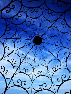 Whimsical Wrought Iron and Blue Skies