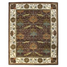Hand-tufted wool rug in chocolate with a mulitcolor floral motif.   Product: RugConstruction Material: 100% Wool