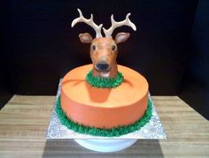 10 inch White cake with Buttercream icing. Deer head shaped from Rice Krispie Treats, covered with fondant, painted with gel colors. I bent lollipop sticks into curves and covered with fondant, then pinched points up to form antlers .
