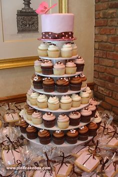You could do one large cupcake stand with a small cake on top to cut.  I found a couple of cupcake stands - round ones and square ones.