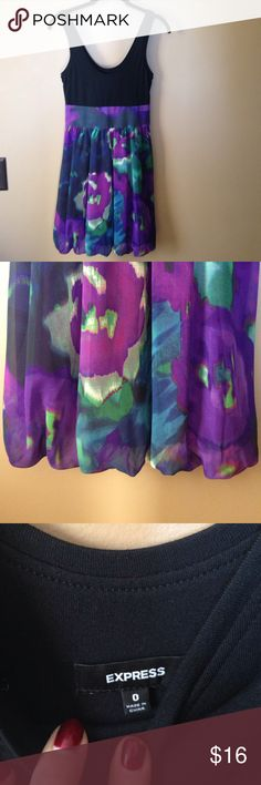 Express Size 0 Dress Beautiful colors/print.  Soft comfortable tank top the skirt part of the dress is full lined.  The tank part is thick so no slip required for this easy to wear beautiful dress.  Side zipper, no flaws. Express Dresses Midi